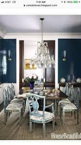 vine scores in the dining room of this manhattan duplex designed by garrow kedigian is a gany table that s surrounded by antique chairs that were
