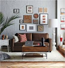 blue walls brown furniture. grey walls with brown leather couch it needs the dark red tones in cushions and pictures to tie two colours together blue furniture