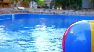 beach ball in pool. Colorful Beach Ball Thrown Into The Water In Pool \u2014 Stock Video I