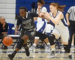 SCC's Lexi Hines, center, drives to the basket against Laney's V