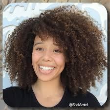 long layered curly bob with bangs