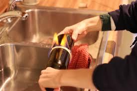 Wine Bottle Lamp Diy Making A Wine Bottle Chandelier Laura Makes