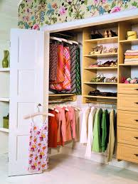 bedroom wall closet designs. Amazing Design Of The Small Closet With Brown Wooden Shelves Added White Wall And Bedroom Designs