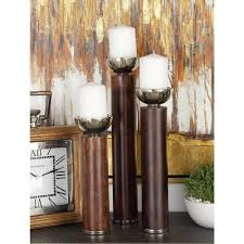 litton lane polished brown wood and silver aluminum round candle holders with cup shaped bobeche