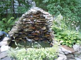 Small Picture Slate wall waterfall into a small garden pond Garden Waterfalls