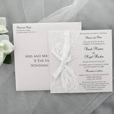 White Wedding Invitation With White Lace And Ribbon