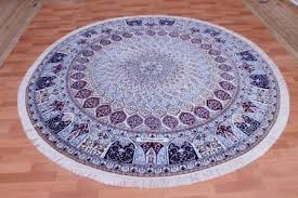 large round nain 6lah persian rug featuring a gonbad design and over 400 kpsi