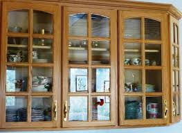 glass cupboard doors with apple dishes behind