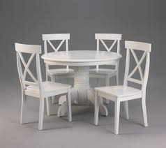 kitchen white round wooden table with big stand and four curving legs plus white wooden