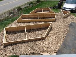 this is a view from the deck that we built the year before showing the finished tzoidal shape of the raised beds and wood chip mulched garden paths