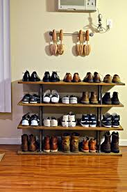 this four tier industrial style shoe rack made from solid wood and steel pipe provides black color shoe rack storage sliding