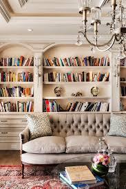 classic bookshelves sofa crystal chandelier home library