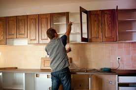 when installing kitchen cabinets start with the upper cabinets and then install the base