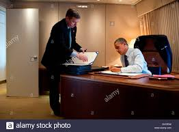 air force one office. us president barack obama signs bills aboard air force one during the flight to cleveland office e