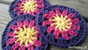 add a little happy sunshine to your table with these pretty and handy coasters crocheted easily and quickly in the round they look fabulous under your