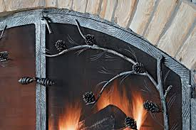 fireplace screen with branches pine needles and pine cones of forged metal rock fireplace with iron