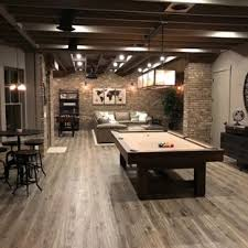 5 Basement  Large Rustic Medium Tone Wood Floor And Brown Basement Idea  In Atlanta With