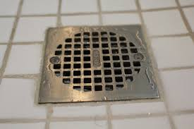 slow draining shower floor drain using no chemicals