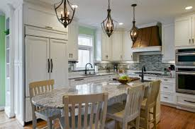 alder wood honey amesbury door eat in kitchen island backsplash diagonal tile stainless teel sink faucet eat in kitchen lighting i85 lighting