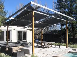 shade structure for outdoor sitting area next to swimming pool with shade sails steel posts