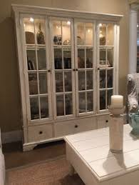 trisha yearwood monticello curio cabinet in whipped cream finish available by special order notice the interior lighting