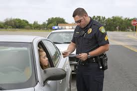 the worst things about being a police officer police officer examining license of teenage girl