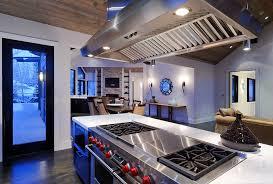 stove exhaust fan kitchen rustic with ceiling lighting dark floor