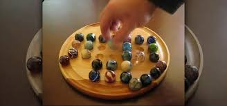 Game With Rocks And Wooden Board Enchanting How To Play Marble Solitaire Board Games WonderHowTo
