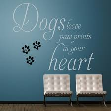 metallic silver and black dogs leave paw prints wall decal in a hallway