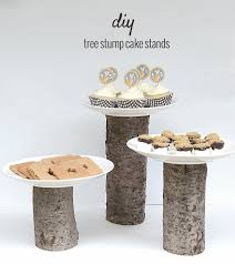 i really love how simple these cake stands are and that they go so well with our fox party theme they have a modern rustic look with the clean white plates