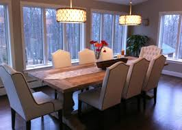dining room with 6 side chairs and 2 host chairs the side chairs have a camel back tapered legs and nailhead trim