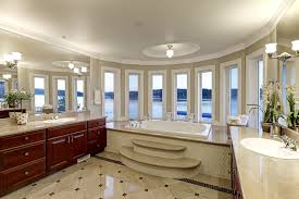 very large master bathroom with bay window
