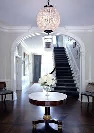 round glass foyer table elegant foyer with starburst parquet hardwood floors framing a marble topped pedestal