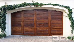 custom wood garage door in a spanish mediterranean style
