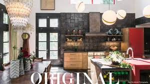 modern steel range hood in eclectic kitchen with floating shelves