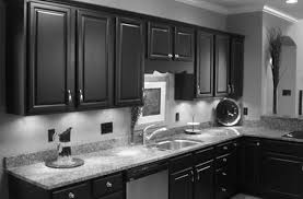kitchen black wooden kitchen cabinets having grey marble countertop with steel sink and faucet on