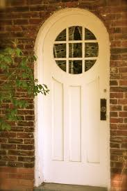 Decorating circular door images : Country cottage front door with arched top and circular window ...
