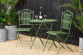 green metal garden table chair set