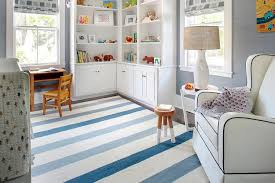 white and blue boy nursery with l shaped bookcase