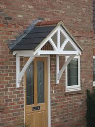 A wide pitched timber door canopy kit ready for felt, slates, leading or  tiling