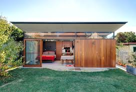 outdoor home office. this modern backyard studio in australia has a home office, living quarters, bathroom with outdoor office