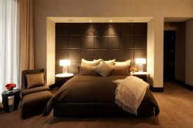 gorgeous brown bedroom theme with modern tall headboard and comfy chair for bedroom design and wooden