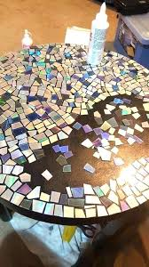 diy mosaic table mosaic table he cuts his old collection into pieces then he grabs the diy mosaic table