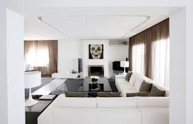 modern apartment interior design living room upholstered furniture skull painting on white wall above fireplace in