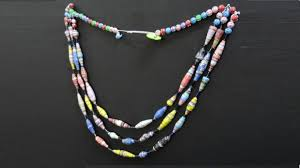 this diy upcycled paper bead necklace can easily be made at home to make the best out of waste paper strips are rolled shaped and glued to form diffe