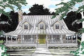 house plans with wrap around porches. A Covered Porch Wraps All The Way Around This Hill Country Home Plan, Offering An Inviting Setting For Outdoor Living. Twin Bay Windows, Stone Chimney And House Plans With Wrap Porches