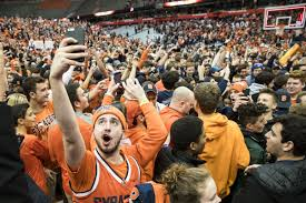 basketball fans cheering. photo by brett carlsen/getty images basketball fans cheering