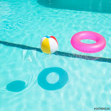 swimming pool beach ball background.  Swimming Bright Pink Float And Beach Balls In Blue Swimming Pool Floating  Refreshing Pool With  On Swimming Pool Beach Ball Background C