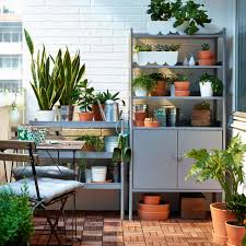 outdoor furniture small balcony. a small balcony with grey shelving units that are filled green plants combined outdoor furniture r