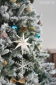 A Turquoise, Teal, Silver and White Vintage Inspired Flocked Christmas Tree